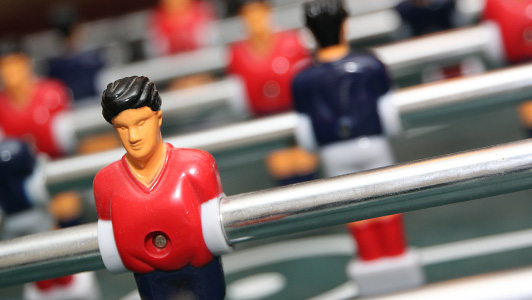A 'player' on a foosball table.