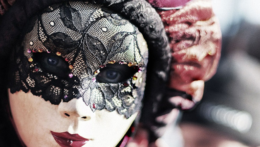 Girl with a Venetian mask with black lace