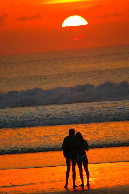 couple at beach watching sunset