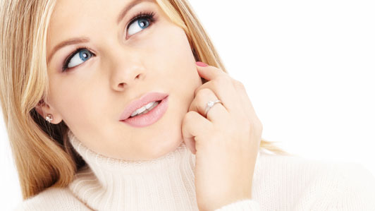 girl in white sweater with wondering look