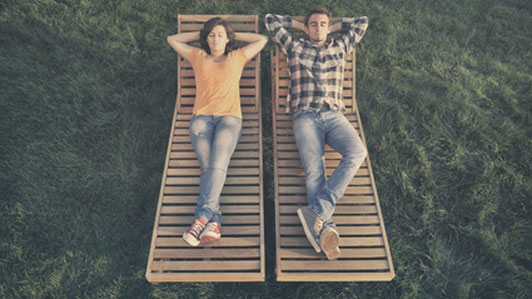 couple sitting on separate lawn chairs