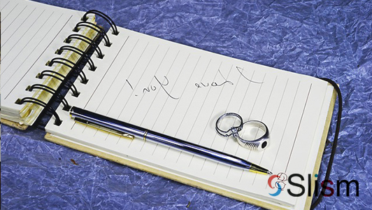 love note, rings, and a pen