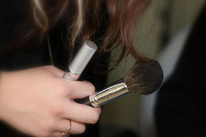 makeup in hand