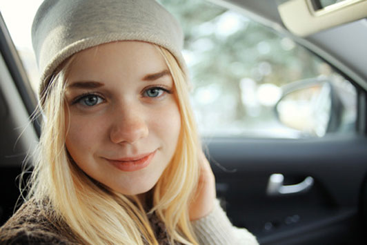 smiling girl in car
