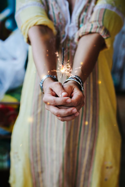 young woman with grip on fireworks