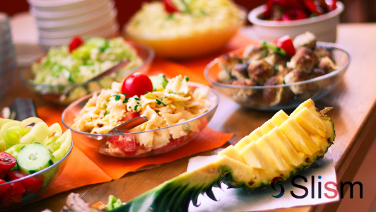 Pineapple and bowls with food