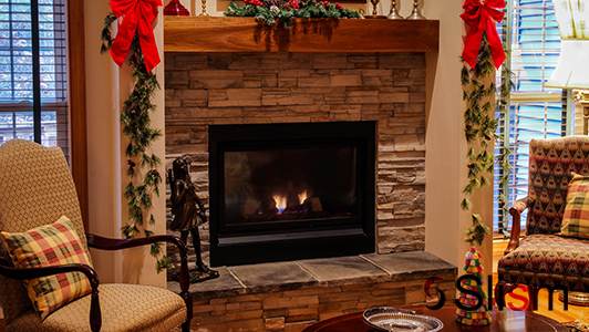 Decorated fireplace and chairs