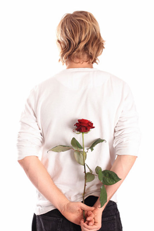 back of guy holding a rose