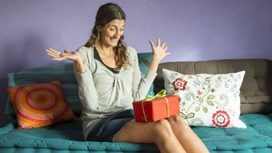 surprised look on person receiving present