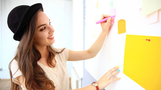 woman writing on wall