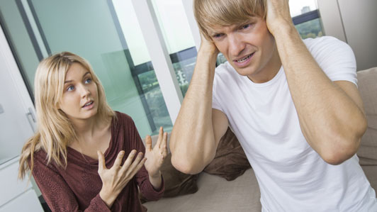 girl trying to tell guy who is not listening something
