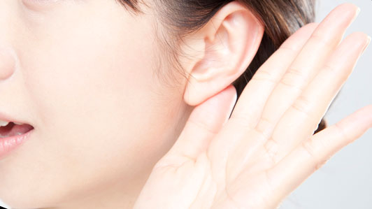 hand and ear of woman listening