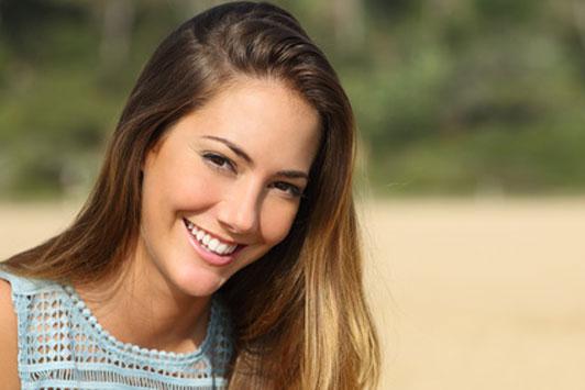 pretty girl in light blue smiling