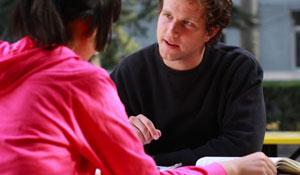 Man explaining something to woman