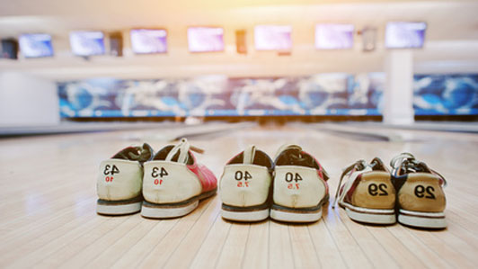 three pairs of bowling shoes