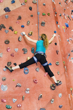 woman rock climbing alone