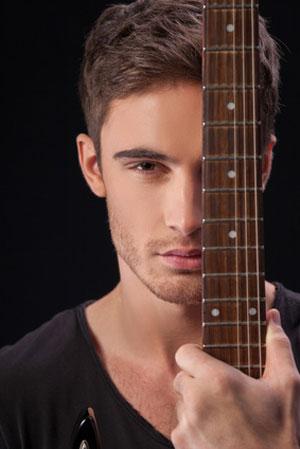 guy hiding behind guitar