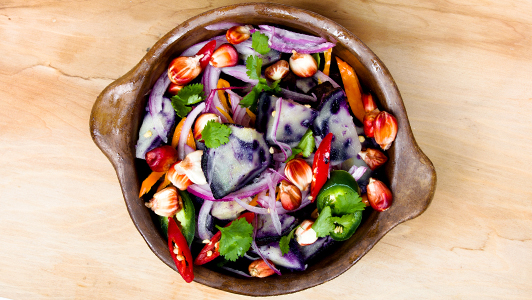 A bowl of colorful salad.