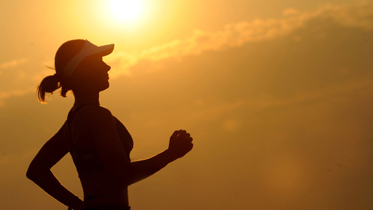 Girl jogging in sunny weather