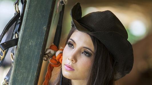 wearing cowboy hat not smiling
