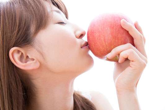 girl kissing apple