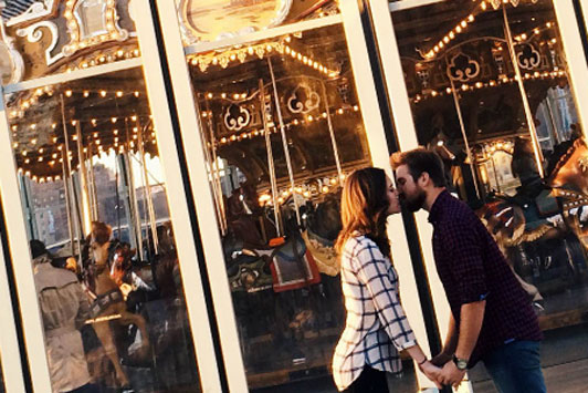 carnival scene of couple kissing
