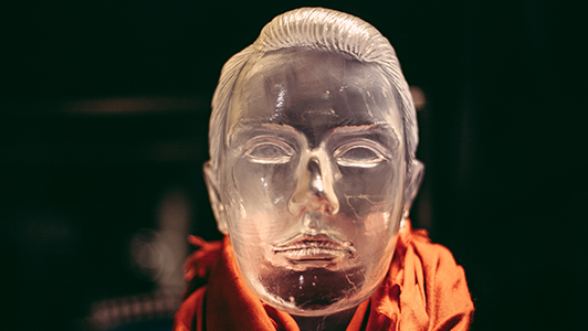 Guy's head made of glass