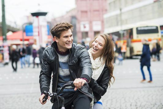 happy young couple on bike