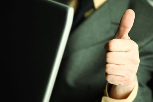 thumbs up from person in suit