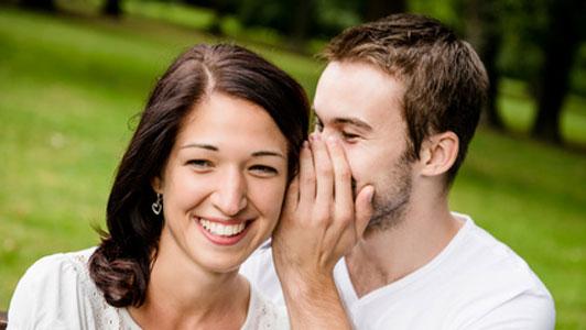 man telling woman his secrets
