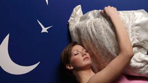 sleeping woman hugging pillow