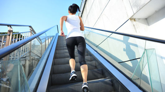 Runner athlete running on escalator stairs