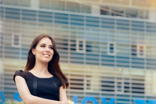 young business woman outside in front of building