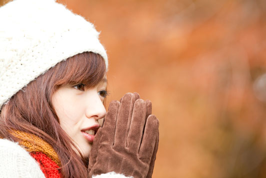 girl wearing gloves with hands together