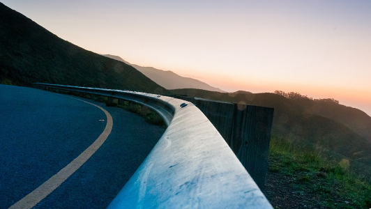 curvy road and a sunset
