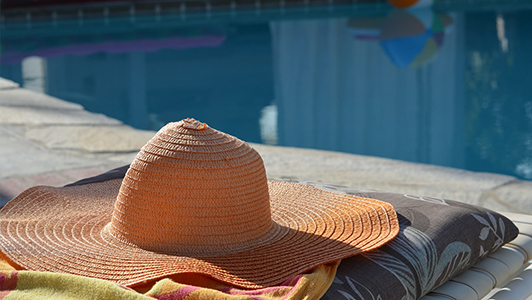 Hat near a pool