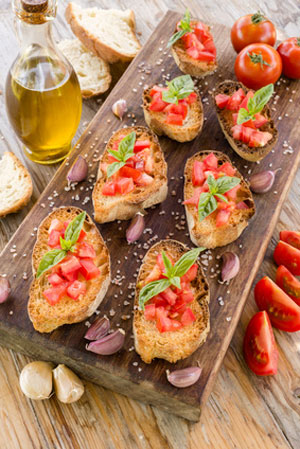 finger food with tomatoes on cutting board