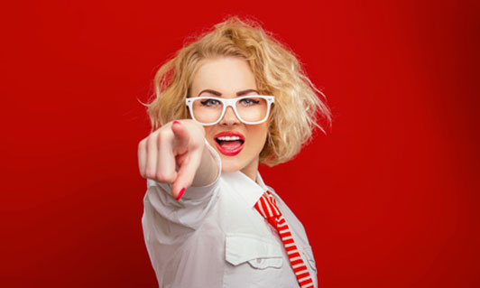 pointing woman in glasses