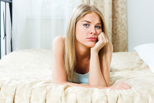 frowning girl on bed