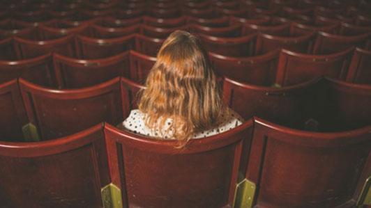 girl alone in cinema