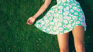 woman in green flower one piece lying in grass