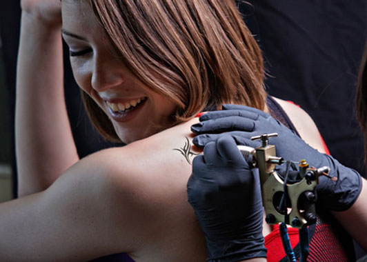 women getting a tattoo