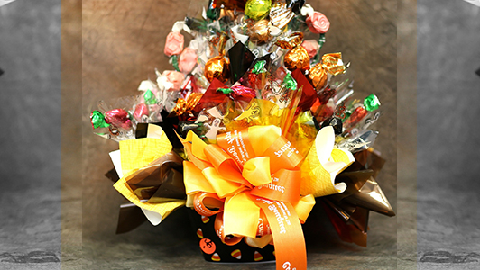 Basket with candy and a big orange bow