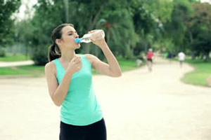 jogging womand drinking water