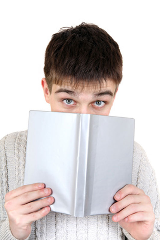 guy hiding behind book