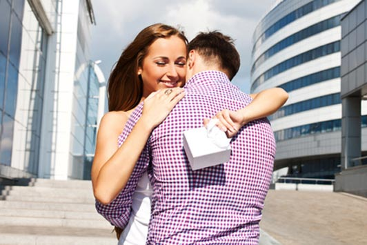 ... things guys wished girls knew about. woman hugging man after getting a  present
