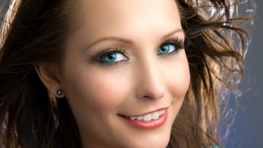 Girl with blue eyes smiling.