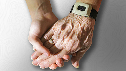 Hand-in-hand with elderly person