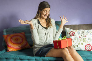 woman surprised receiving gift