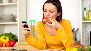 woman eating while on phone